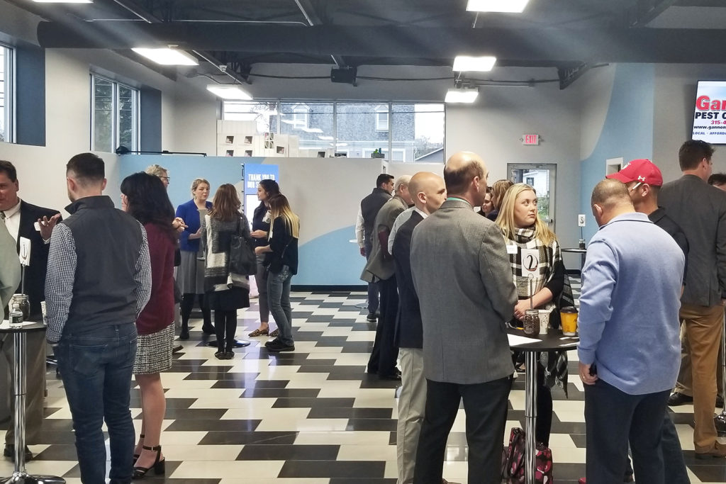 Groups of people networking at Coffee and Connections, held at RBM